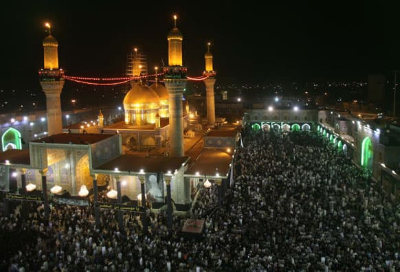 Shiite pilgrims pray at the Imam Moussa al-Kadhim shrine at Kazimiyah district of Baghdad, Iraq.
