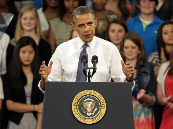 """President Barack Obama speaks to students, teachers, and guests at Mooresville Middle School in Mooresville, N.C., during his """"Middle Class Jobs & Opportunity Tour""""."""