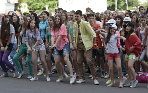 Russian fans of South Korean musician PSY perform a