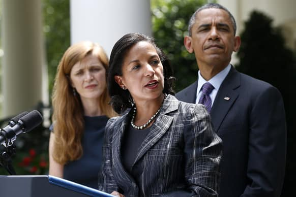 President Barack Obama listens as UN Ambassador Susan Rice, his choice to be his next National Security Adviser, speaks in the Rose Garden at the White House in Washington.