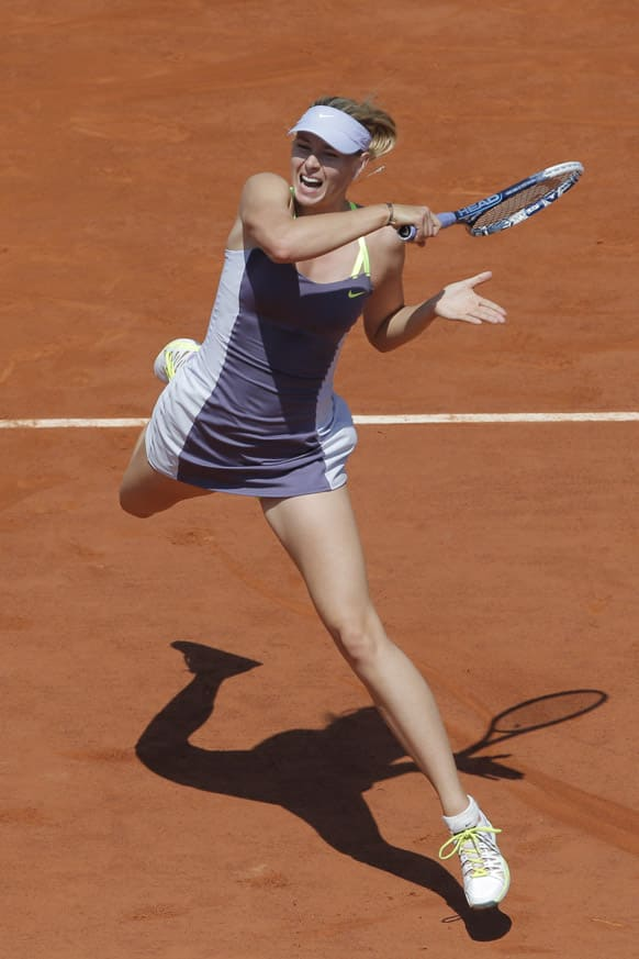 Russia`s Maria Sharapova returns against Serbia`s Jelena Jankovic in their quarterfinal match at the French Open tennis tournament, at Roland Garros stadium in Paris.