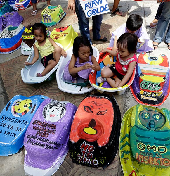 Children display baby tubs painted with protest messages during a rally on World Environment Day at suburban Quezon city northeast of Manila, Philippines.