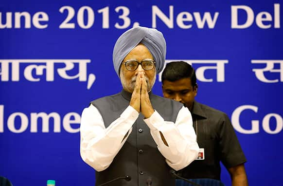 Prime Minister Manmohan Singh greets people upon arrival for a conference of the Chief Ministers of various Indian states on Internal Security in New Delhi, India.