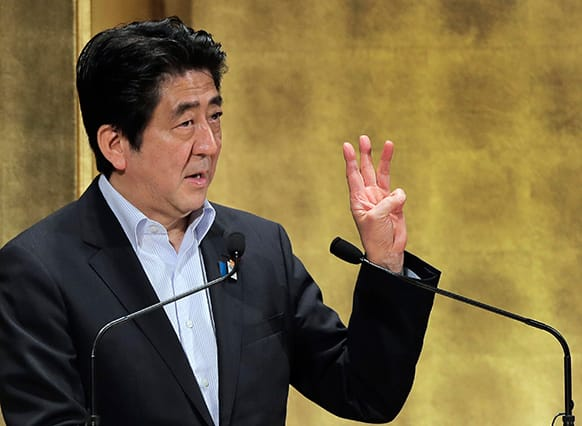 Japanese Prime Minister Shinzo Abe gestures during a speech at a seminar in Tokyo.