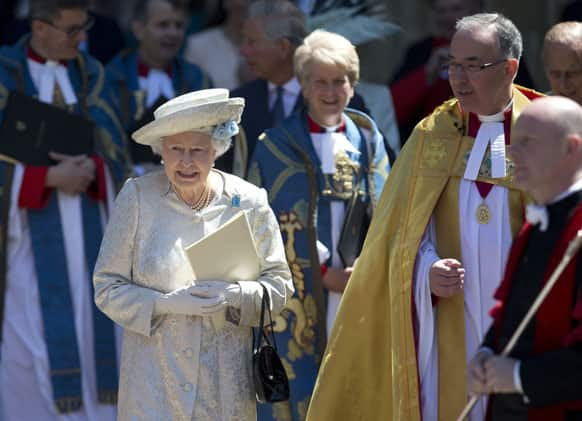 Britain`s Queen Elizabeth II escorted by the Dean of Westminster Abbey, Dr John Hall, leave after a service to celebrate the 60th anniversary of the coronation of the Queen at Westminster Abbey, London.