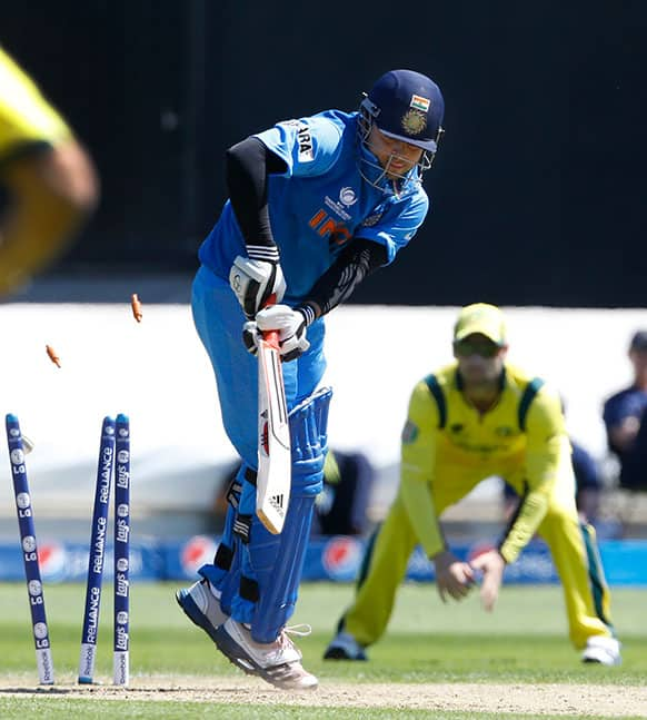 India`s Suresh Raina is bowled for no score off the bowling of Australia`s Clint McKay during a warm up cricket match for the upcoming ICC Champions Trophy between India and Australia at the Cardiff Wales Stadium in Cardiff.