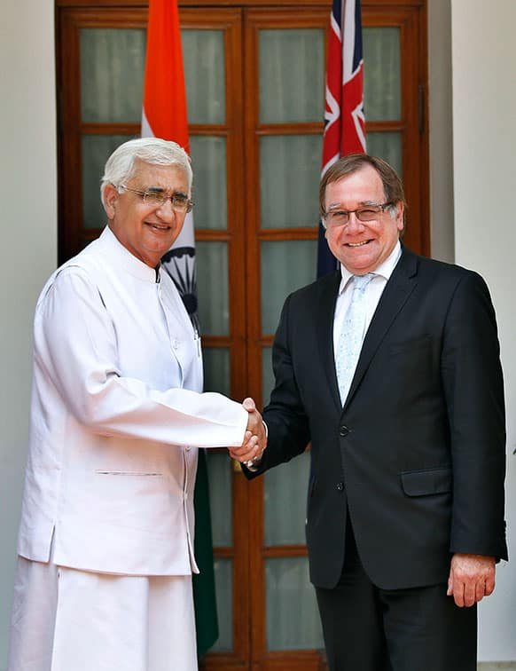 New Zealand`s Foreign Minister Murray McCully, right, and Indian External Affairs Minister Salman Khurshid, pose for the media as they arrive for a meeting in New Delhi.