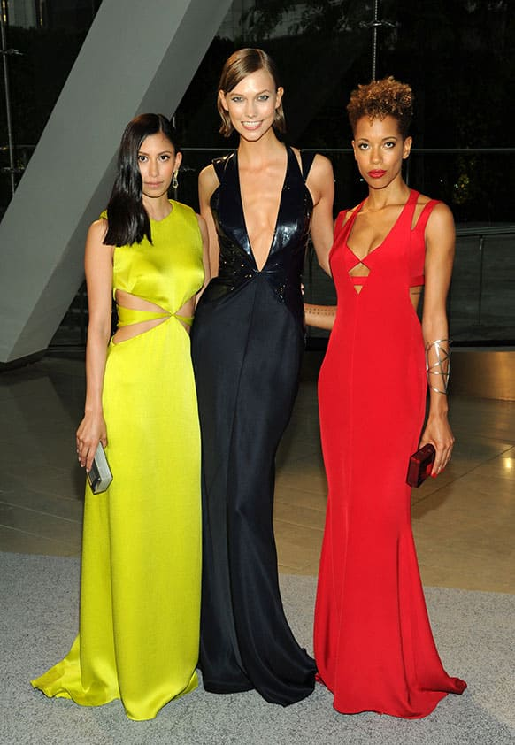 Designer Michelle Ochs, left, model Karlie Kloss, center and designer Carly Cushnie attend the 2013 CFDA Fashion Awards at Alice Tully Hall in New York.