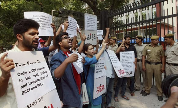 All India Students` Association activists shout slogans demanding that the ongoing spot-fixing scandal in the IPL cricket be investigated by the Central Bureau of Investigation during a protest outside the Sports Ministry office in New Delhi.
