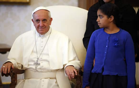 Pope Francis sits as the daughter of Cape Verde`s President Jorge Carlos Fonseca (unseen) looks at him during a private audience at the Vatican.
