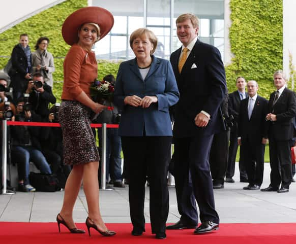 German Chancellor Angela Merkel, welcomes King Willem-Alexander of the Netherlands and Queen Maxima, for a meeting at the chancellery in Berlin.