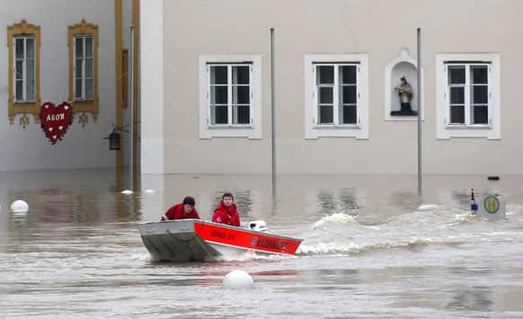 Members of the red cross make their way by boats in the flooded street in the centre of Passau, southern Germany.