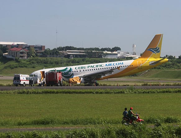 A Cebu Pacific Airbus A320 passenger plane sits on the side of a runway Monday, June 3, 2013 after it overshot the runway upon landing at Davao International Airport in southern Philippines on Saturday evening.