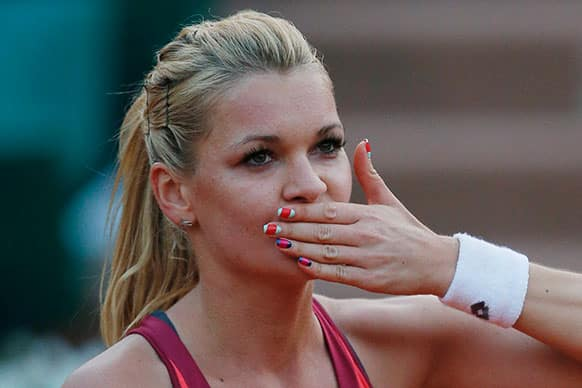 Poland`s Agniezska Radwanska blows a kiss to spectators after defeating Serbia`s Ana Ivanovic in their fourth round match at the French Open tennis tournament.