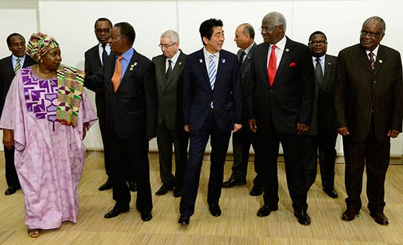 Japanese PM Shinzo Abe, escorts Sierra Leone`s President Ernest Bai Koroma, Chairperson of the African Union Commission Nkosazana Dlamini-Zuma, and other representatives from African countries prior to the Japan-Africa summit meeting on United Nations Security Council reform at the TICAD.