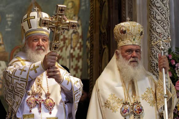 Russian Orthodox Patriarch Kirill I, left, and Archbishop of Athens Ieronimos, lead a Sunday mass at the church of Agios Panteleimonas in Athens.