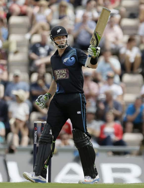 New Zealand`s Martin Guptill, raises his bat as he acknowledges the crowd for reaching fifty runs, during their second one day international cricket match against England, at the Ageas Bowl in Southampton, England.