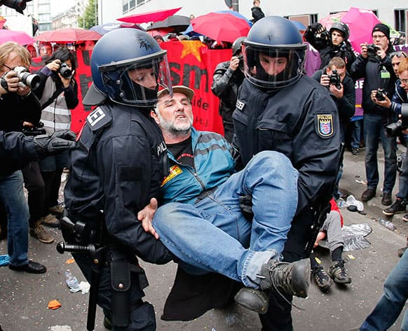 A demonstrator is carried away by German police during an anti capitalism Blockupy protest in Frankfurt.