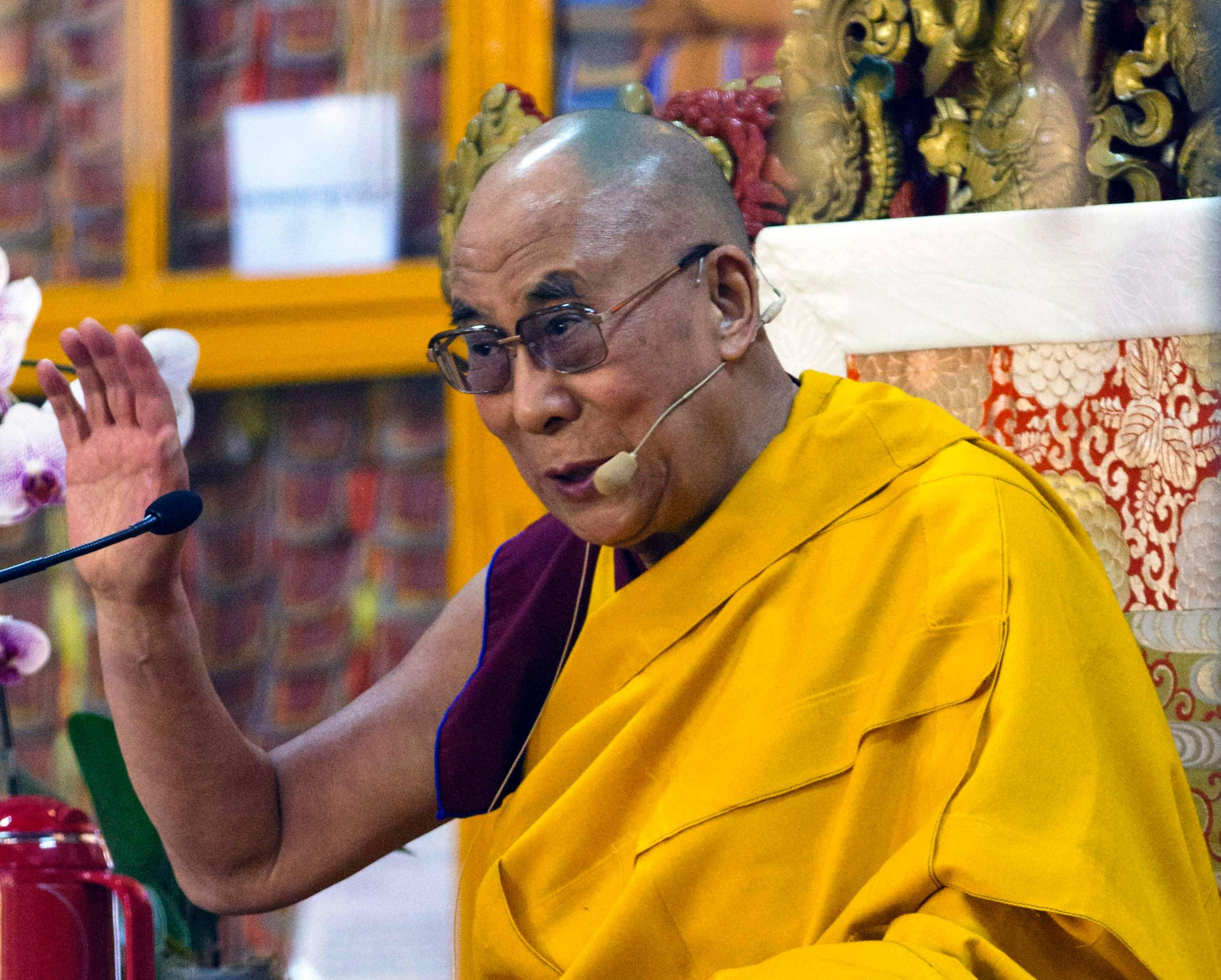 Tibetan spiritual leader the Dalai Lama gestures during a religious talk at the Tsuglakhang temple in Dharmsala.