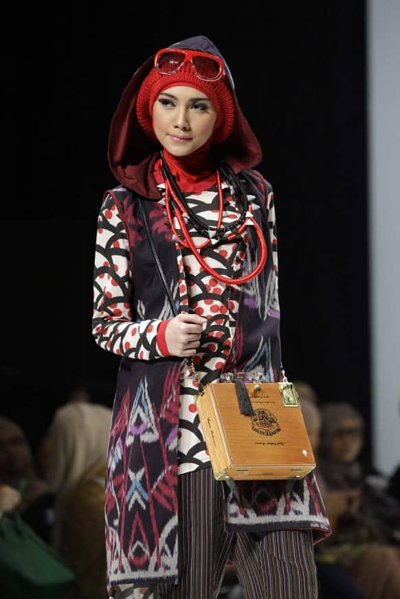 A model displays a creation of Indonesian designer Hannie Hananto during Indonesia Islamic Fashion Fair in Jakarta.
