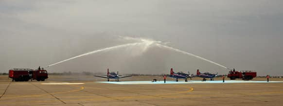 Pilatus PC-7 Swiss made planes are sprayed with water during the Induction Ceremony at Dundigal, 40 kilometers (25 miles) from Hyderabad. Ten PC-7s have been inducted into Indian Air Force (IAF) as the Basic trainer for new pilots.