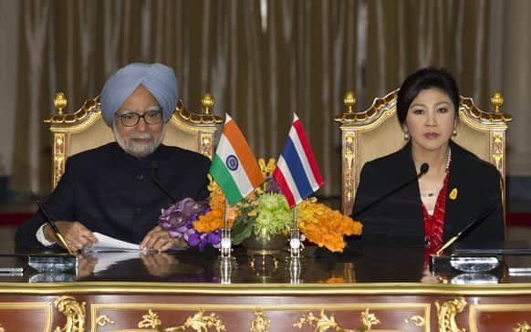 India`s Prime Minister Manmohan Singh speaks during a joint press conference with Thailand`s Prime Minister Yingluck Shinawatra at the government house in Bangkok, Thailand. Singh is on a two-day visit to Thailand.
