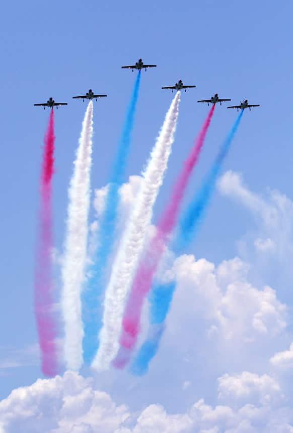 A fleet of AT-3 Jet trainers perform at the Chihang airport during an air show of Taiwan air force in Taitung County, Taiwan.