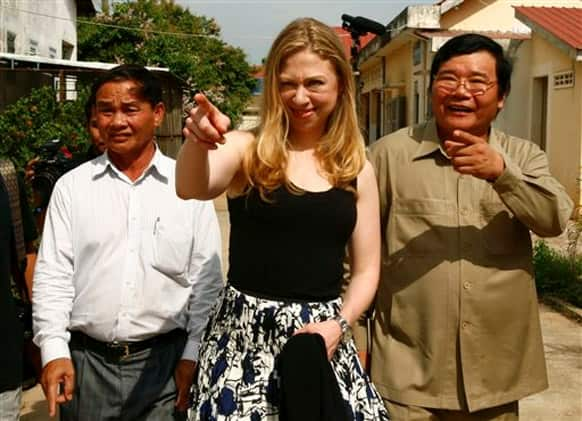Chelsea Clinton, daughter of former US President Bill Clinton, gestures as she tours with Cambodian Dr. Mean Chhi Von, director of the National Center of HIV/AIDS, in Neak Loeung town, Prey Veng province.