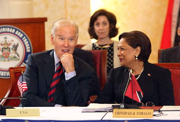 Vice President Joe Biden, left, listens to Trinidad & Tobago`s Prime Minister Kamla Persad-Bissessar during their meeting at the Diplomatic Center in St. Anns, Trinidad.