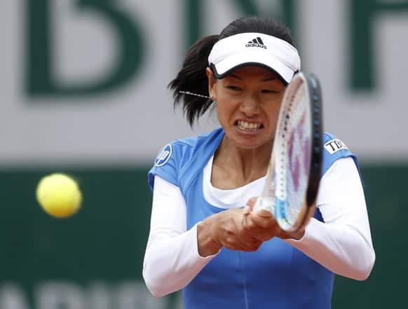 Japan`s Kimiko Date-Krumm returns the ball to Australia`s Samantha Stosur during their first round match of the French Open tennis tournament at the Roland Garros stadium in Paris.