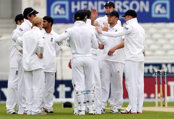 England`s Jonathan Trott celebrates with his teammates after catching out New Zealand`s Tim Southee on the fifth day of the second Test match between England and New Zealand at Headingley cricket ground in Leeds, England.
