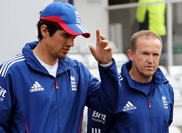 England coach Andy Flower, right, and captain Alastair Cook, left, are seen walking off the field ahead of the fifth day of the second Test match between England and New Zealand at Headingley cricket ground in Leeds, England.