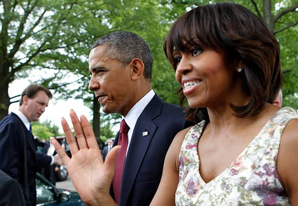 President Barack Obama and first lady Michelle leave after visiting Section 60 of Arlington National Cemetery on Memorial Day in Arlington, Va.