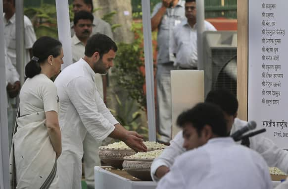India`s Congress party president Sonia Gandhi and vice president Rahul Gandhi pay tribute to those killed in Saturday`s Maoist attack in Chhattisgarh at a prayer meeting held at the party`s headquarters in New Delhi.