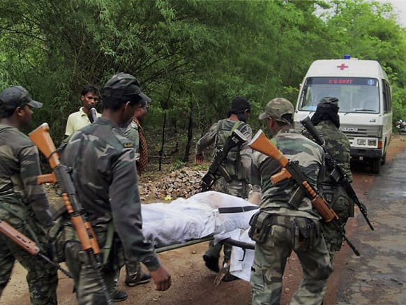 Indian security personnel carry the body of one of the victims of Saturday's Maoist attack in a densely forested area in Bastar, about 345 kilometers (215 miles) south of Raipur, Chhattisgarh.