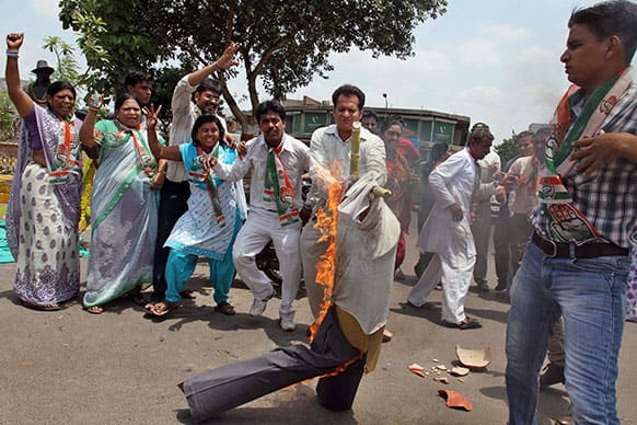 Supporters of India`s ruling Congress party burn an effigy representing Maoist rebel during a protest in Ahmadabad.