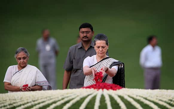 India`s ruling Congress party President Sonia Gandhi, center, and Delhi state Chief Minister Sheila Dikhsit, left, pay tribute to country's first Prime Minister Jawaharlal Nehru on his 49th death anniversary at his memorial in New Delhi.