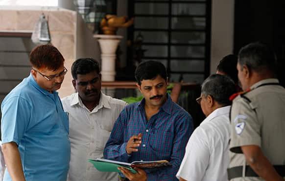 India's Mumbai Crime Branch police officers raid the residence of Gurunath Meiyappan, the chief executive of the Chennai Super Kings cricket team in Chennai, India.