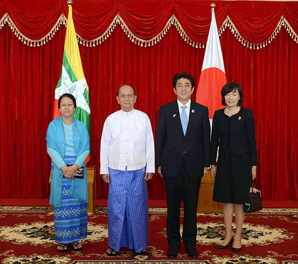 Myanmar President Thein Sein, second from left, his wife Khin Khin Win, left, Japanese Prime Minister Shinzo Abe, second from right, and his wife Akie, right, pose for photos during their meeting at the Presidential Palace in Naypyitaw, Myanmar.