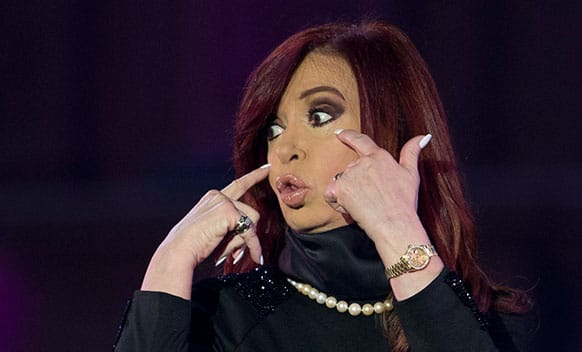 Argentina`s President Cristina Fernandez gestures to supporters at a rally outside the government house in Buenos Aires, Argentina.