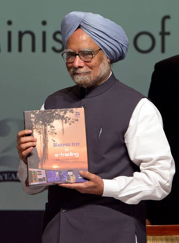 Indian Prime Minister Manmohan Singh releases a book during the Silver Jubilee celebration of Securities and Exchange Board of India, SEBI in Mumbai.
