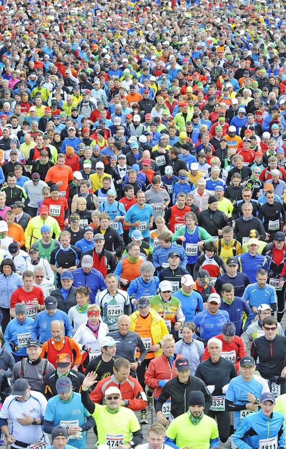 Runners start at the `GutsMuths Rennsteiglauf` marathon, one of Europe`s most popular cross-country races, in Neuhaus am Rennweg, Germany.