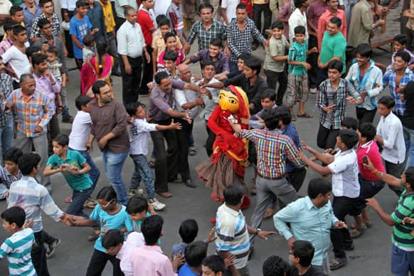 Men tease a character Nakti, the sister of demon Hiranyakashyap, as ritualistic celebrations to mark Narsingh Jayanti in Ajmer.