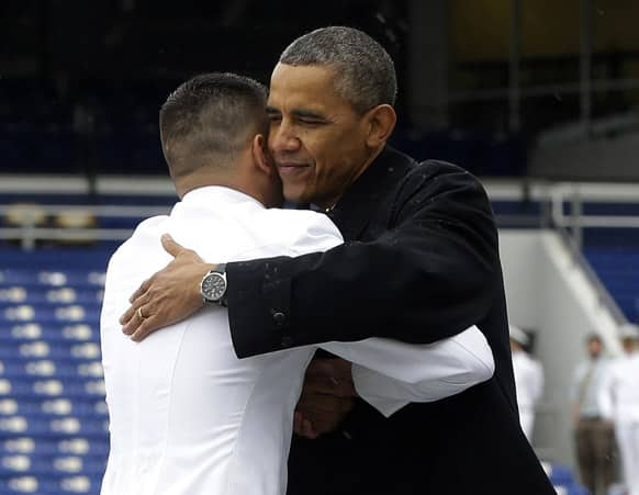 President Barack Obama embraces a member of the 2013 graduating class at the United States Naval Academy commncement ceremony in Annapolis, Md.