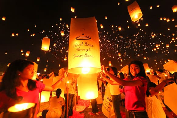 Thousands of youths release into the sky paper lanterns to celebrate