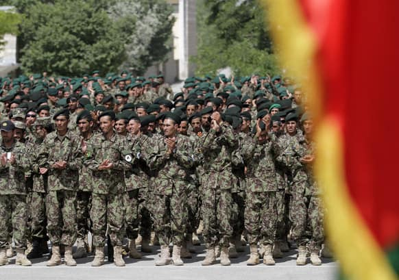 New Afghan Army recruits attend a graduation ceremony at the Afghan National Army (ANA) base on the outskirts of Kabul, Afghanistan.