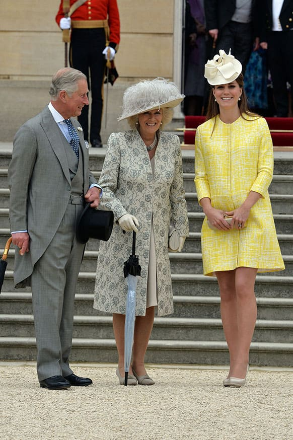 Britain`s Prince Charles, left, Camilla Duchess of Cornwall, centre, and Kate Duchess of Cambridge attend a Garden Party hosted by Queen Elizabeth II in the grounds of Buckingham Palace, central London.