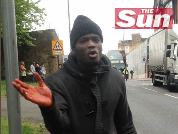 This image taken from video made available by The Sun newspaper shows what appears to be one of the attackers speaking to the camera after a brutal attack in broad daylight Wednesday, May 22, 2013 near a military barracks in London.