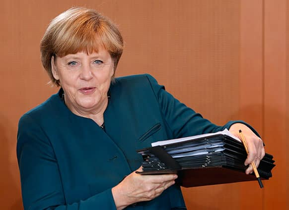 German Chancellor Angela Merkel arrives for the weekly cabinet meeting at the chancellery, in Berlin.