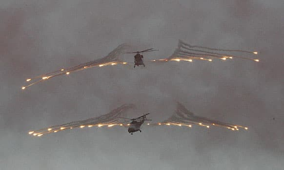 South Korean Army`s first produced military helicopters, the Surion, fire flare shells during the rehearsal of the ceremony to celebrate its deployment, at the Army Aviation School in Nonsan, South Korea.
